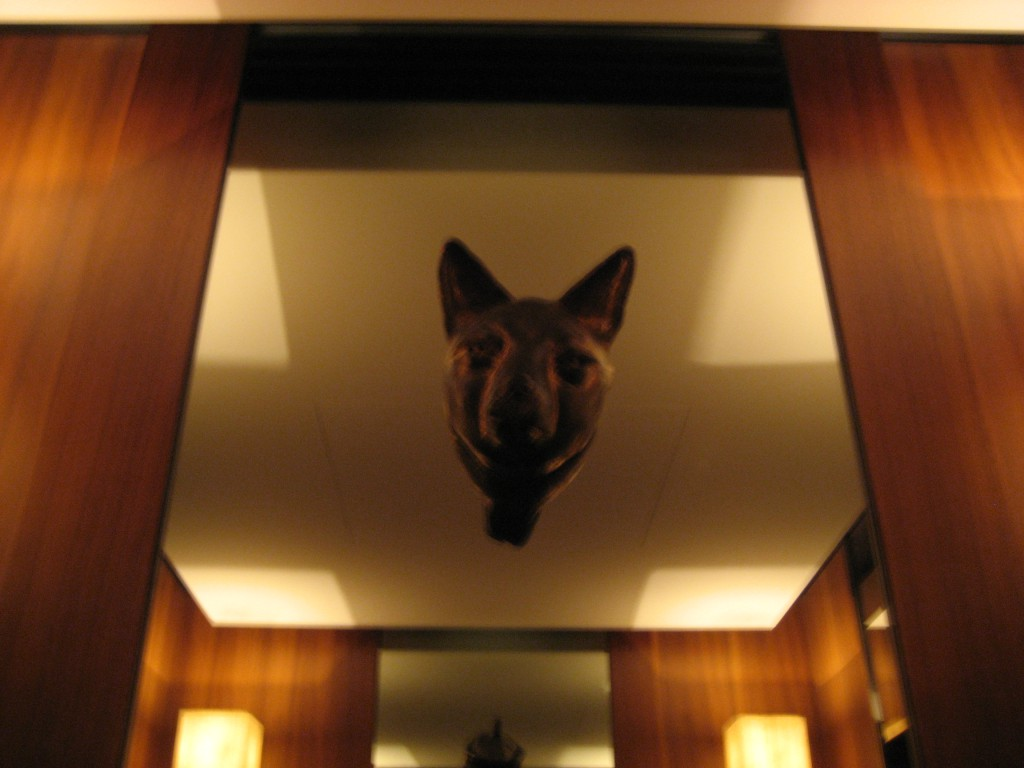 One of three mirrored walls with a bronze head poking out, which can be found inside the elevator of the Park Hyatt building. (Photo: Brian Cramer)