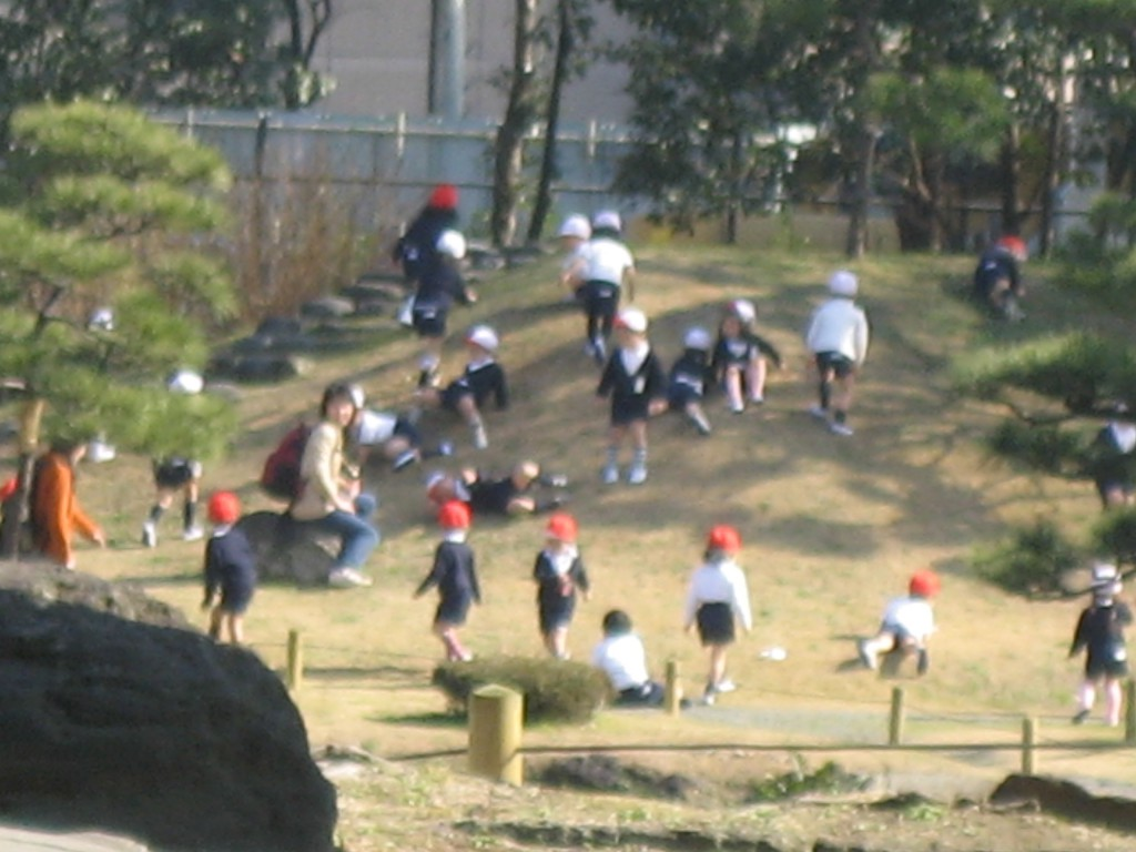 Thirty little kids, dressed in little sailor suits and red caps, screaming at the top of their lungs while rolling down a hill in unison and making a big pile of little kids at the bottom.