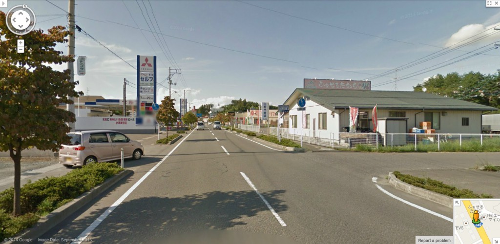 The usual collection of gas stations, grocery stores, and car dealerships that are found the world over along these sorts of roads. (Photo: Google)